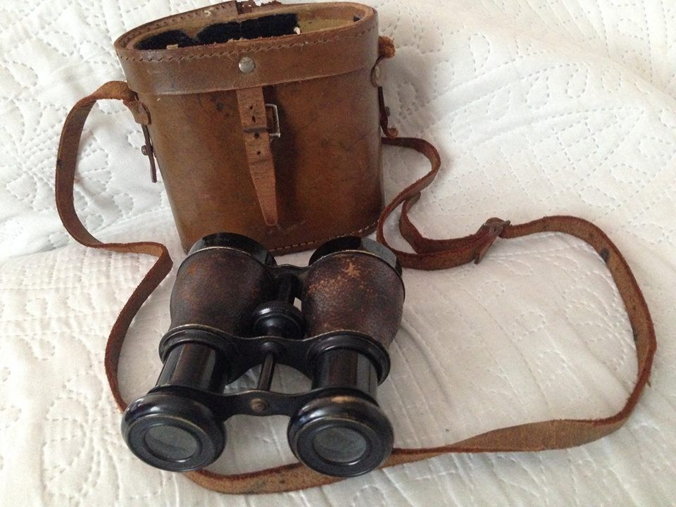 sports marine binoculars with leather case.
