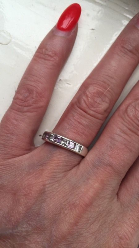 Sold pure silver stoned half eternity ring enhanced to give this ring enhanced stones