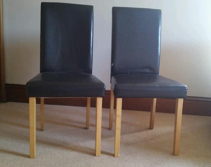 2 leather look dining chairs