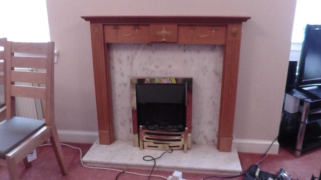 Marble fireplace, timber surround and electric fire