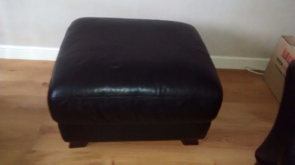 2 Seater Italian black leather couch with large footstool bought from Sterling warehouse