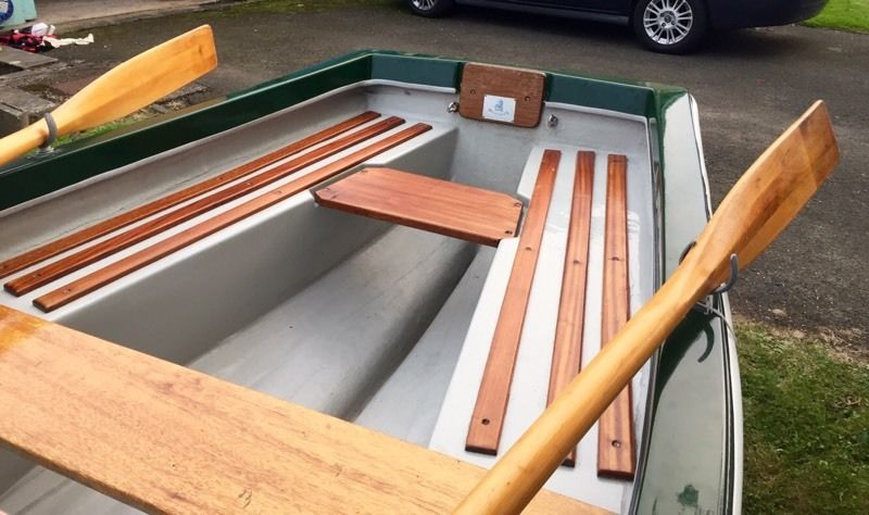 Beautiful 12ft Heyland fishing boat complete with anchor, oars, rowlocks and road trailer.