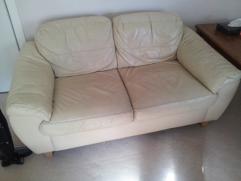 Two cream leather sofas free for uplift