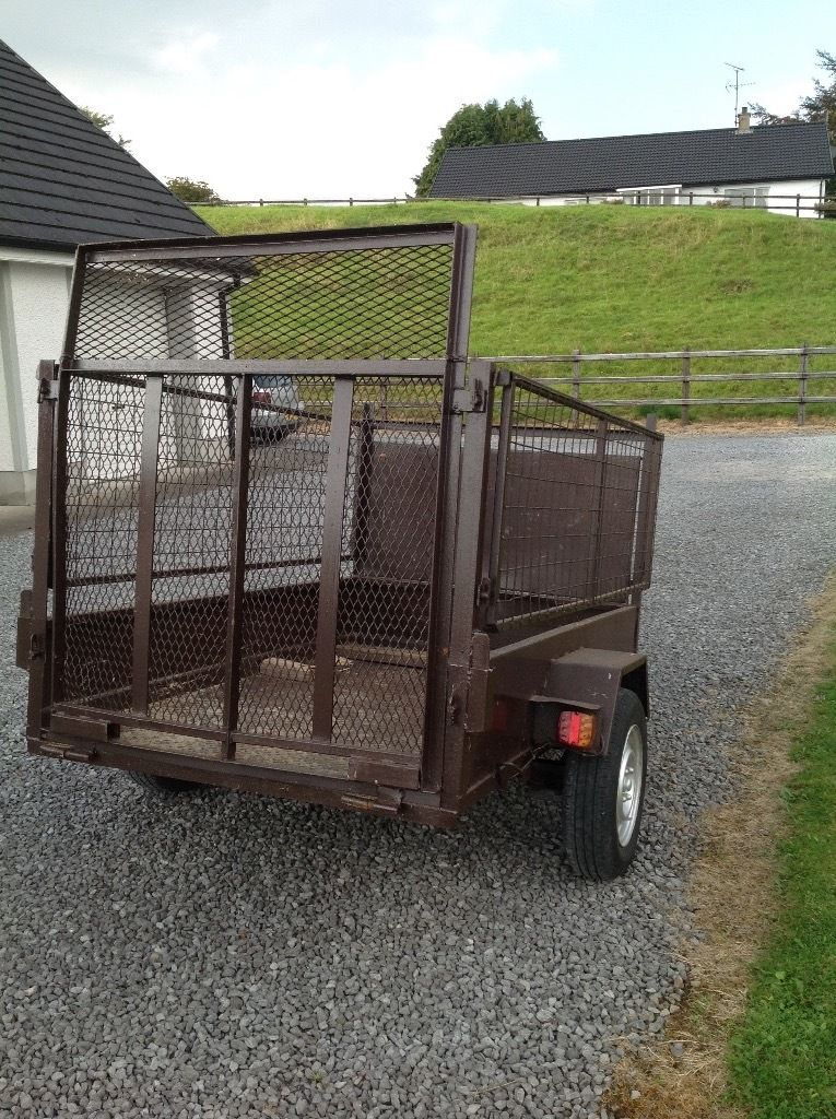 CAR TRAILER WITH MESH SIDES