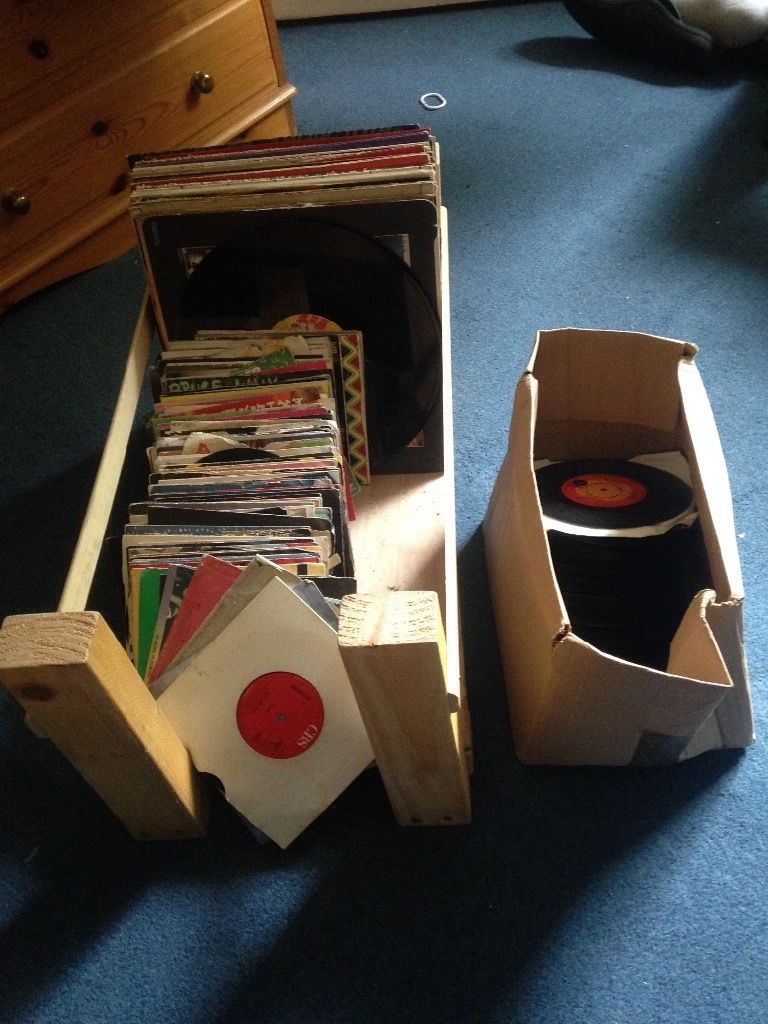 Offers welcome: 100s of vinyls, singles and LPs plus display rack