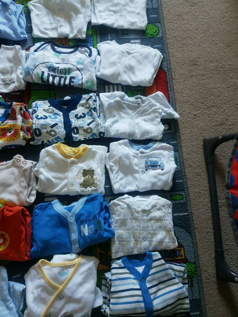 27 newborn/0-3 sleepsuits