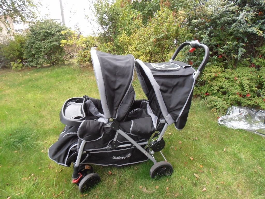 Tandem buggy complete with liners/covers raincover shopping tray. Fully foldable
