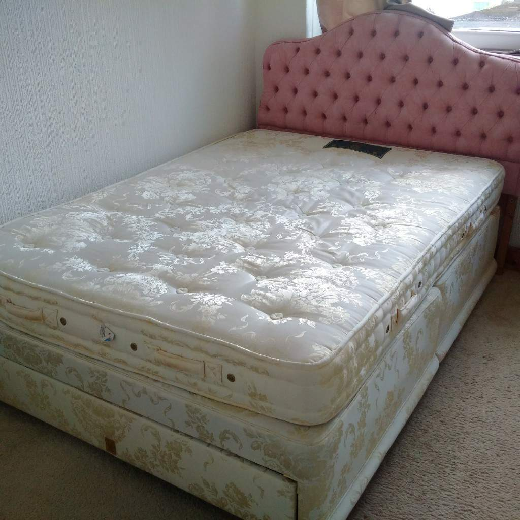 Double divan bed with head board