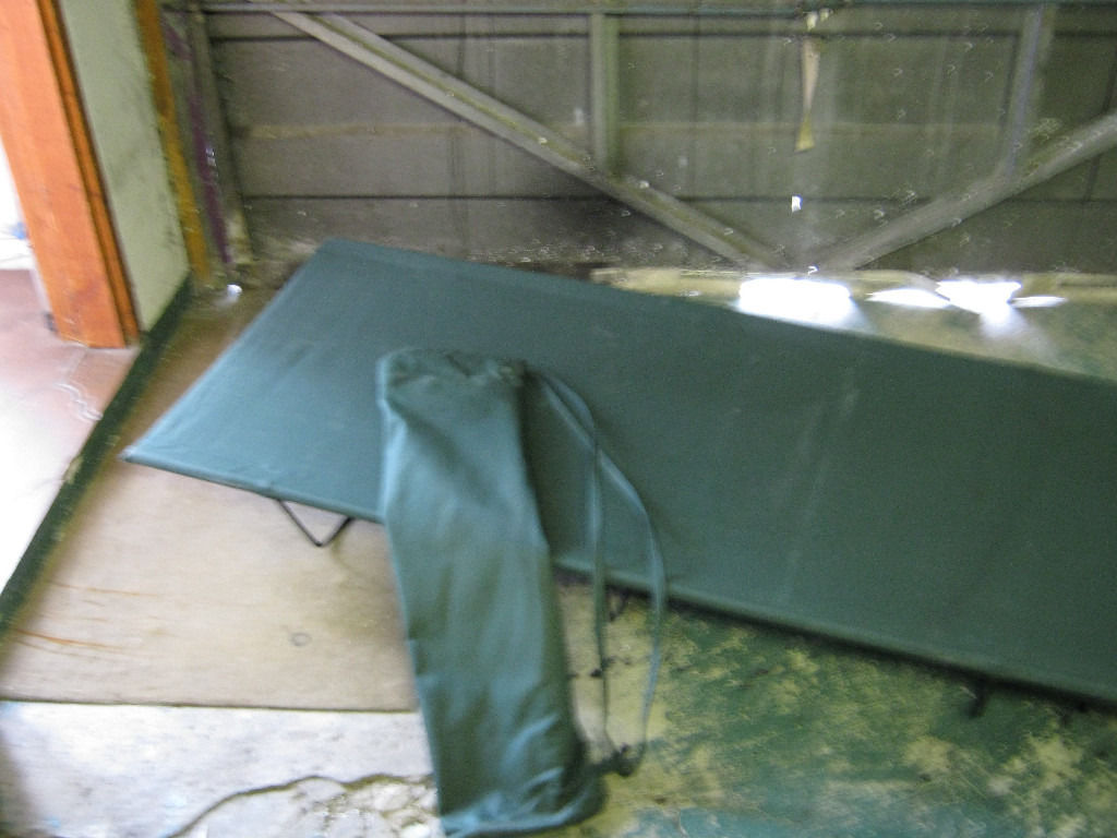 Green single person campbed