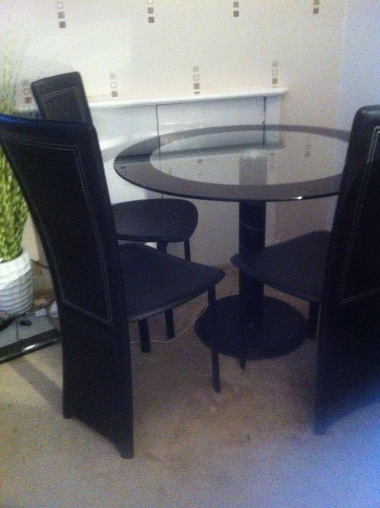 Glass dining table plus 4 chairs