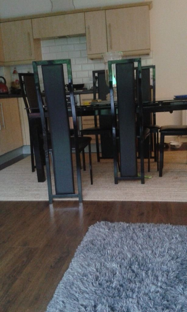 Harveys extending black glass dining table and 6 chairs