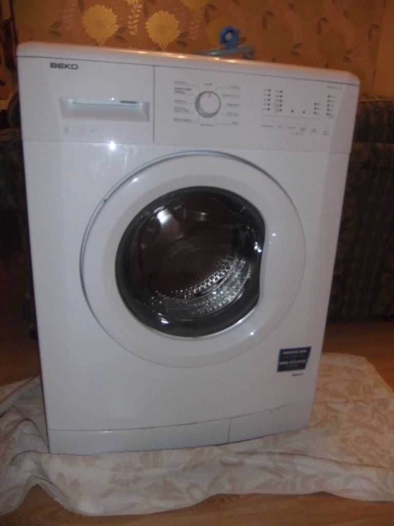 Beko Slimline Washing Machine 1200spin, delay start, 2 years old any reasonable offer accepted