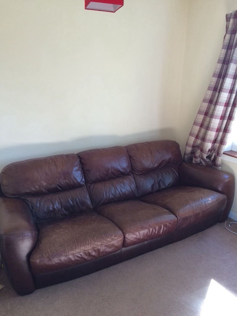 Brown leather 3 seat sofa with matching armchair.