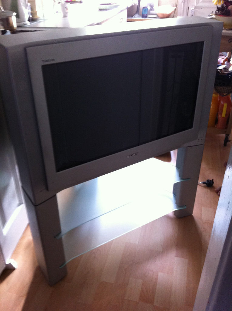 SONY large tv with original tv stand table, silver. Origina remote, FREE to first person