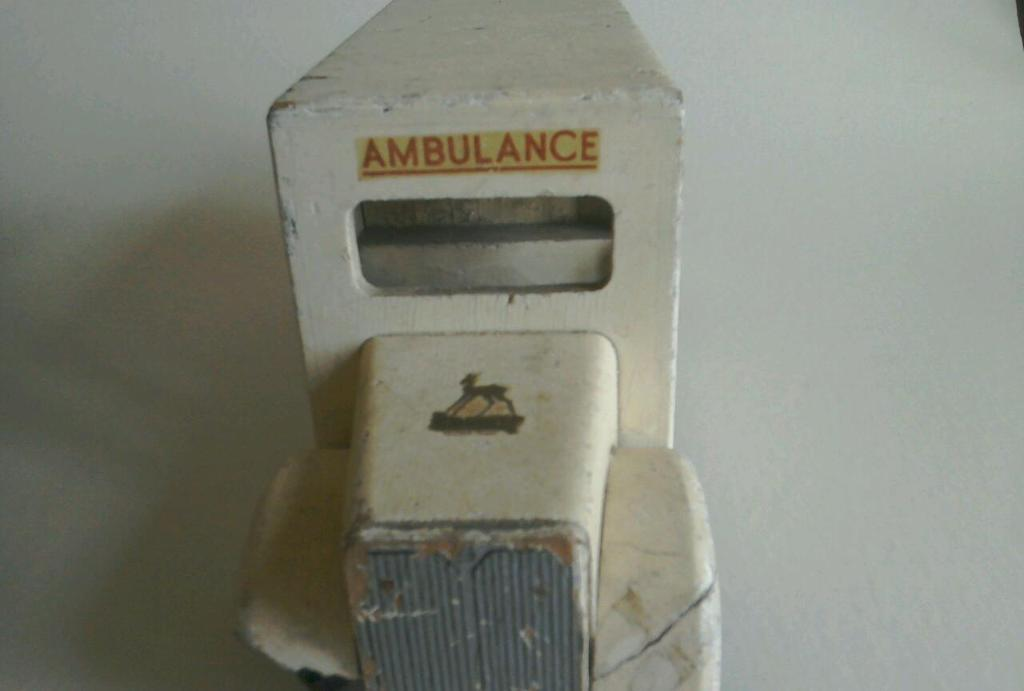 Old wooden toy ambulance