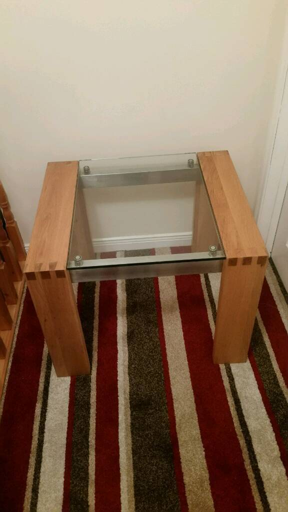 Solid oak and polished toughen glass table set