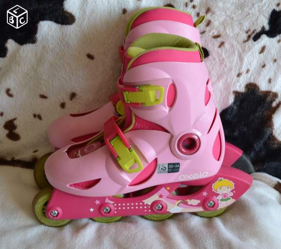Raider - rollers rose marque oxelo taille 32/34